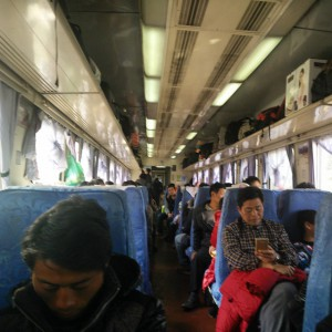 February_12__2015_at_0127PM_Train_to_Kunming._Hard_seat_this_time._5_seats_in_a_row.